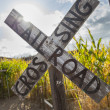 Stock Photo: Antique Country Rail Road Crossing Sign Near a Corn Fiel
