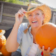 Beautiful Blond Female Rancher Wearing Cowboy Hat Holds a Pumpki — Stock Photo