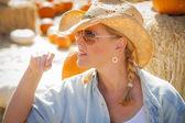 Beautiful Blond Female Rancher Wearing Cowboy Hat in Pumpkin Pat — Stock Photo