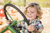 Adorable Young Boy Playing on an Old Tractor Outside — Stock Photo