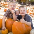 Two Boys at the Pumpkin Patch with Thumbs Up — Stock Photo