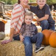 Portrait of Attractive Mother and Her Sons at Pumpkin Patc — Stock Photo