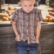 Frustrated Boy at Pumpkin Patch Farm Standing Against Wood Wagon — Stock Photo