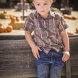 Little Boy With Hands in His Pockets at Pumpkin Patc — Stock Photo