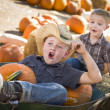 Two Little Boys Playing in Wheelbarrow at the Pumpkin Patc — Stock Photo