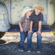 Two Young Boys Wearing Cowboy Hats Leaning Against Antique Truck — ストック写真