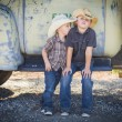 Two Young Boys Wearing Cowboy Hats Leaning Against Antique Truck — 图库照片