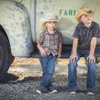 Two Young Boys Wearing Cowboy Hats Leaning Against Antique Truck — Stock Photo