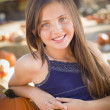 Preteen Girl Portrait at the Pumpkin Patch — Stock Photo #33816739