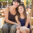 Attractive Mother and Daughter Portrait at the Pumpkin Patc — Stok fotoğraf