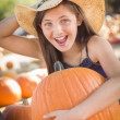 Preteen Girl Holding A Large Pumpkin at the Pumpkin Patc — Stock Photo