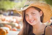 Preteen Girl Portrait Wearing Cowboy Hat at Pumpkin Patch — Stock Photo