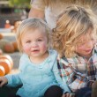 Young Family Enjoys a Day at the Pumpkin Patch — Stock Photo #33919871