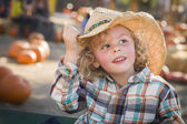 Little Boy in Cowboy Hat at Pumpkin Patch — Stock Photo