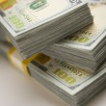 Stacks of Newly Designed One Hundred Dollar Bills — Stock Photo #34315335
