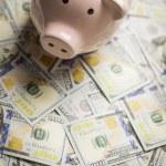 Piggy Bank on Newly Designed One Hundred Dollar Bills — Stock Photo