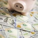 Piggy Bank on Newly Designed One Hundred Dollar Bills — Stock Photo #34315621