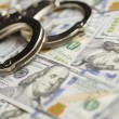Stock Photo: Handcuffs and Newly Designed One Hundred Dollar Bills