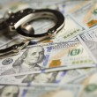 Handcuffs and Newly Designed One Hundred Dollar Bills — Stock Photo