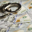 Handcuffs and Newly Designed One Hundred Dollar Bills — Stock Photo #34508465