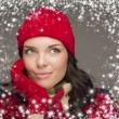 Mixed Race Woman Wearing Winter Hat and Gloves Enjoys Snowfal — Stock Photo