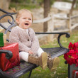 Young Toddler Child Sitting on Bench with Christmas Gifts Outsid — Stock Photo