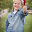 Young Boy Wearing Holiday Clothing Giving a Thumbs Up Outside — Stok fotoğraf