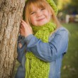 Portrait of Cute Young Girl Wearing Green Scarf and Hat — Stock Photo #35881369