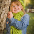 Portrait of Cute Young Girl Wearing Green Scarf and Hat — Stock Photo #35881381