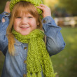Portrait of Cute Young Girl Wearing Green Scarf and Hat — Stock Photo