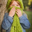 Portrait of Cute Young Girl Wearing Green Scarf and Hat — Stock Photo #35881405