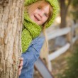 Portrait of Cute Young Girl Wearing Green Scarf and Hat — Stock Photo #35881431