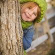 Portrait of Cute Young Girl Wearing Green Scarf and Hat — Stock Photo #35881459