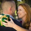 Beautiful Woman and Handsome Military Man Exchange Christmas Gif — Stock Photo #35884311