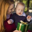 Beautiful Young Mother and Baby with Christmas Gift — Stockfoto