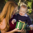 Beautiful Young Mother and Baby with Christmas Gift — Stock Photo