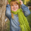 Portrait of Cute Young Girl Wearing Green Scarf and Hat — Stock Photo #35884361