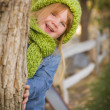 Portrait of Cute Young Girl Wearing Green Scarf and Hat — Stock Photo #35884369