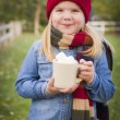 Cute Young Girl Holding Cocoa Mug with Marsh Mallows Outside — Stock Photo #35884371