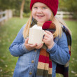 Cute Young Girl Holding Cocoa Mug with Marsh Mallows Outside — Stock Photo #35884387