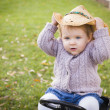 Toddler Wearing Cowboy Hat and Playing on Toy Tractor Outside — Stock Photo