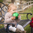 Toddler Child Sitting on Bench with Christmas Ornament Outside — Stock Photo
