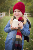 Cute Young Girl Holding Cocoa Mug with Marsh Mallows Outside — Stock Photo