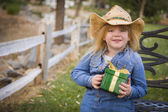 Young Girl Wearing Holiday Clothing Holding Christmas Gift Outsi — Stock Photo