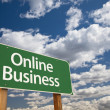 Stock Photo: Online Business Green Road Sign and Clouds