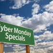 Stock Photo: Cyber Monday Specials Green Road Sign and Clouds