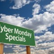 Cyber Monday Specials Green Road Sign and Clouds — Stock Photo