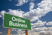 Online Business Green Road Sign and Clouds — Stock Photo