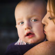 Adorable Red Head Infant Boy is Kissed By His Mother — Stock Photo