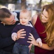 Stock Photo: Infant Boy and Young Military Parents Play in the Park